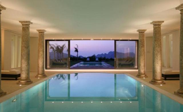 Beca invests in luxurious indoor pool beca bilingual for Luxury house plans with indoor pool